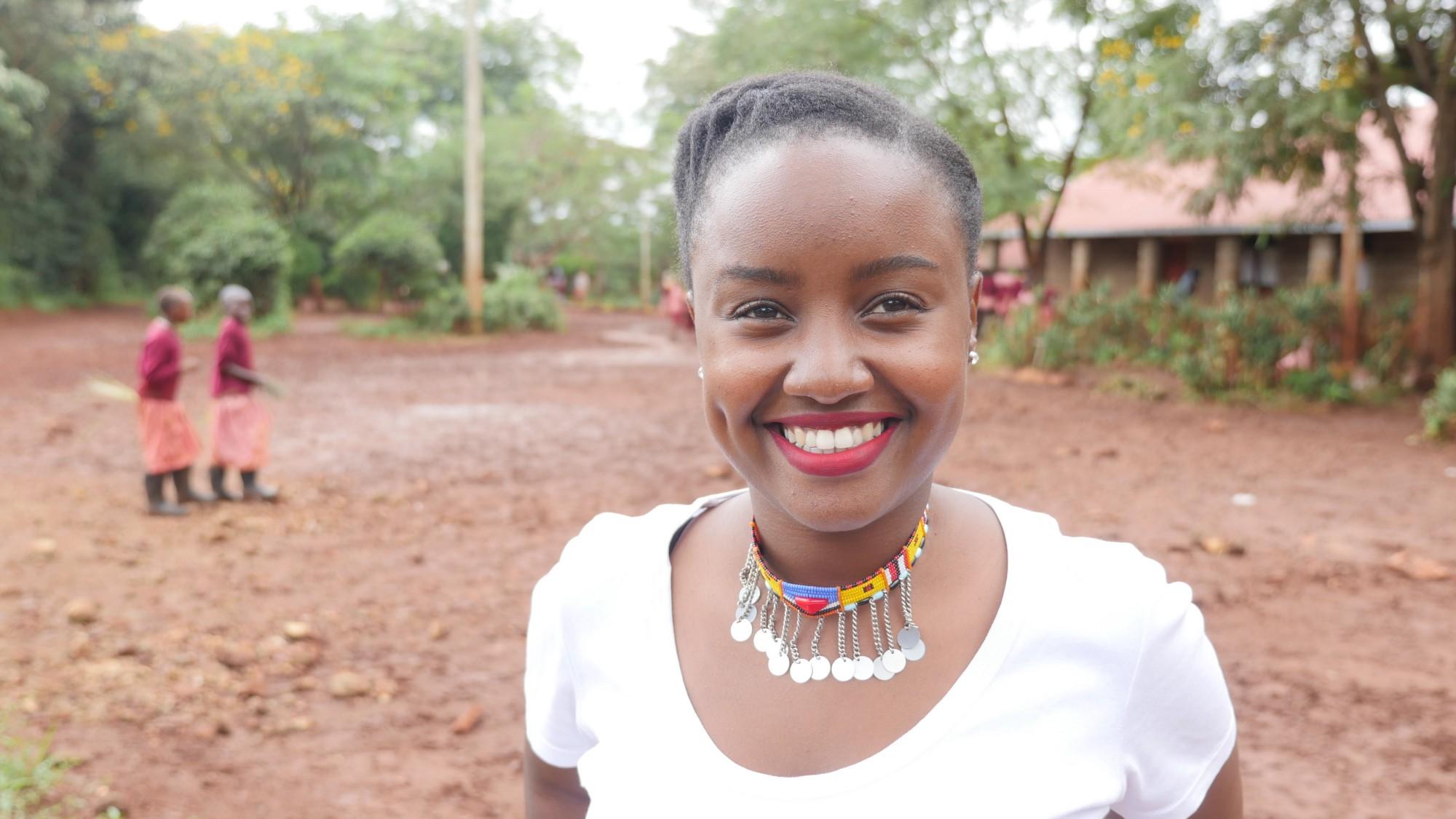 Young Kenyan woman standing in school yard