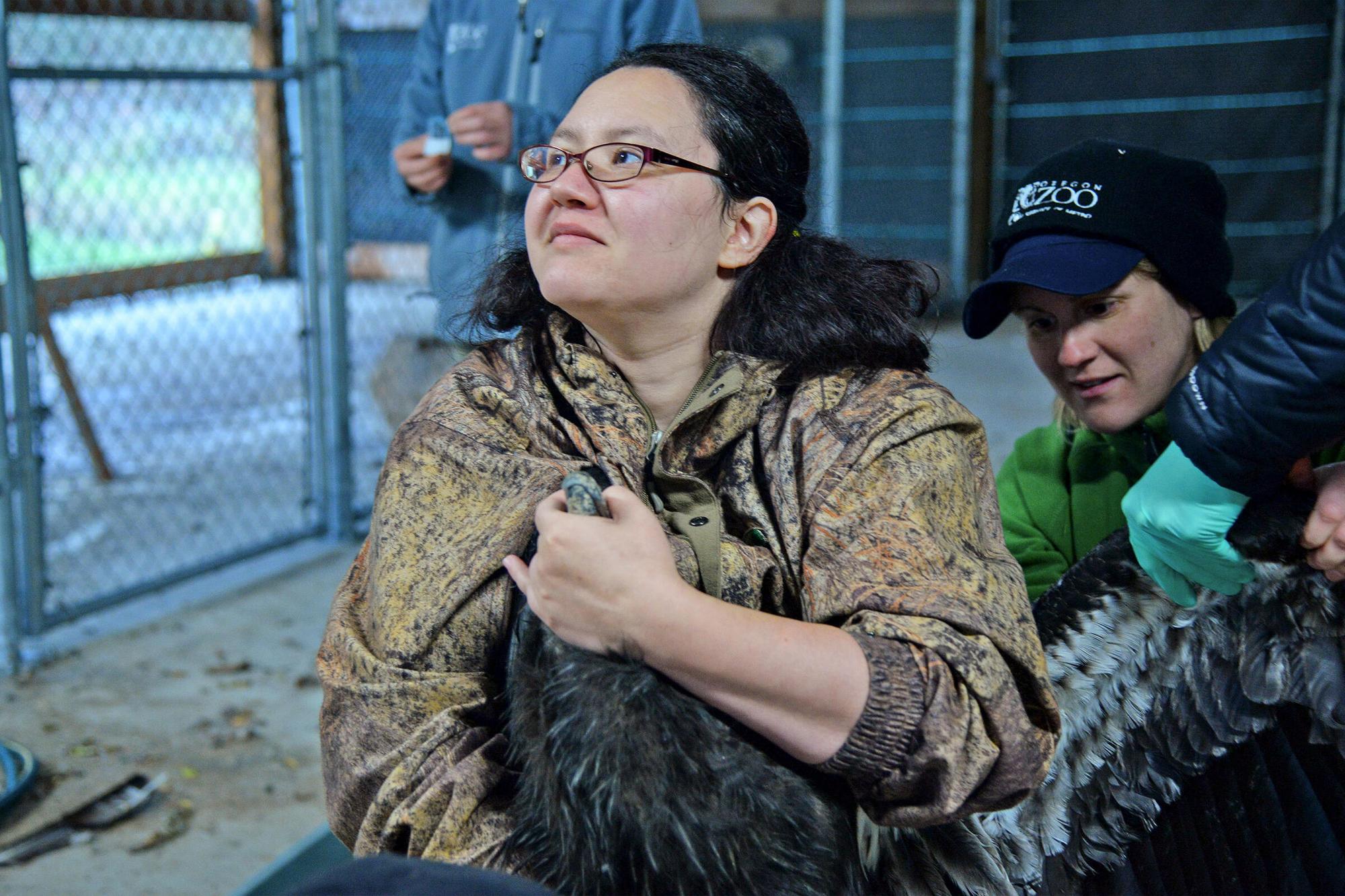 woman holding a condor