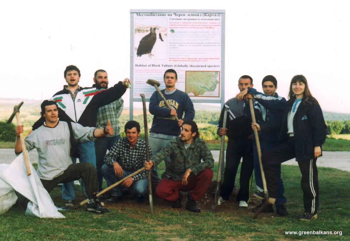 volunteers standing in front of sign