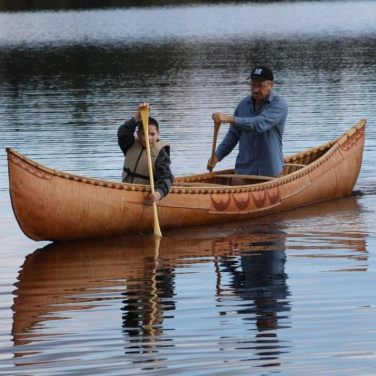 man in canoe with son