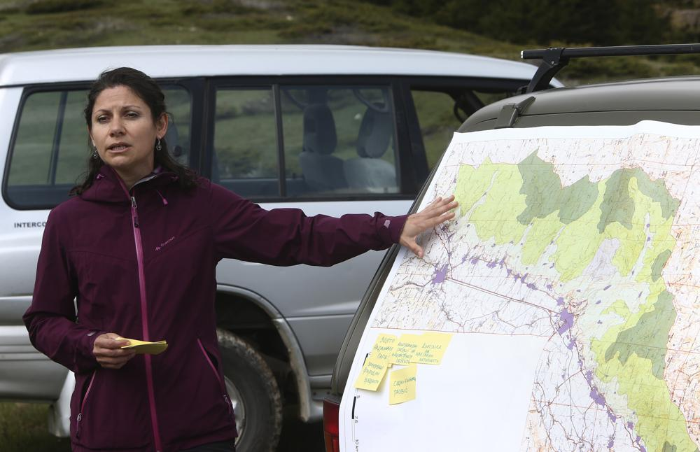women points at map